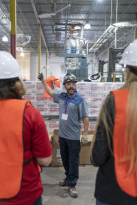 National Gypsum Employee takes L&W Supply Associates through plant