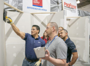 National Gypsum Employee demonstrates the application of ProForm