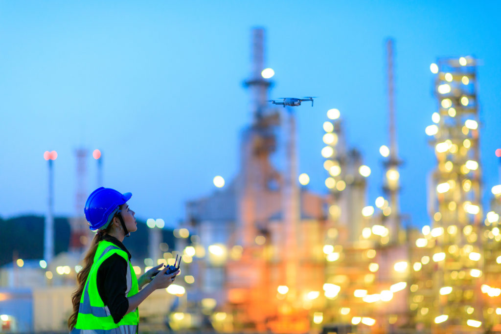 L&W Supply Women Employee Using Drone For Top View Inspection At The Refinery Plant